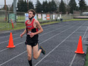 Camas junior Evan Jenkins crosses the finish line at the 4A Greater St. Helens League cross country meet on Wednesday at Battle Ground High School. It was likely the final high school cross country race here for Jenkins, who plans to move with his family to Israel for his senior year.