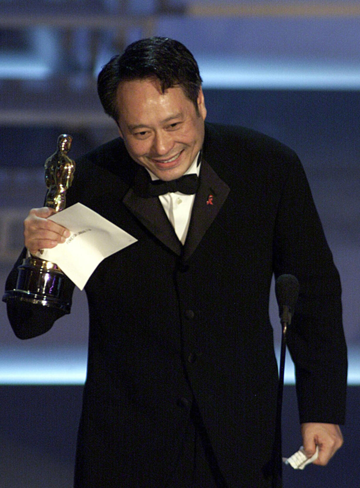 """Taiwanese director Ang Lee holds his Oscar for Best Foreign Language Film for """"Crouching Tiger, Hidden Dragon""""  at the 73rd Annual Academy Awards at the Shrine Auditorium in Los Angeles on March 25, 2001. (Timothy A."""