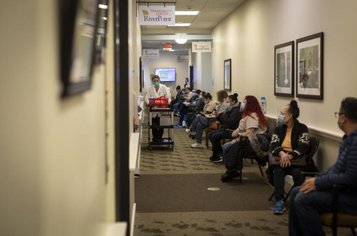 Staff at Rose Villa Senior Living in Oak Grove, just outside of Portland, wait and watch as the first Pfizer coronavirus vaccines arrive on December 21, 2020.