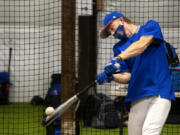 Ridgefield senior Aidan Hundt swings during batting practice. Hundt sustained a broken leg his sophomore year playing football, but is back on the diamond and ready to lead the Spudders.