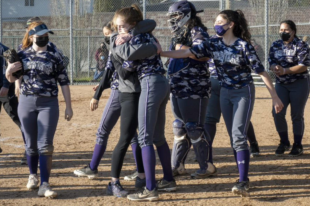 Heritage slowpitch softball players celebrate a win over Prairie this season (Photo courtesy of Troy Wayrynen, Heritage High School)