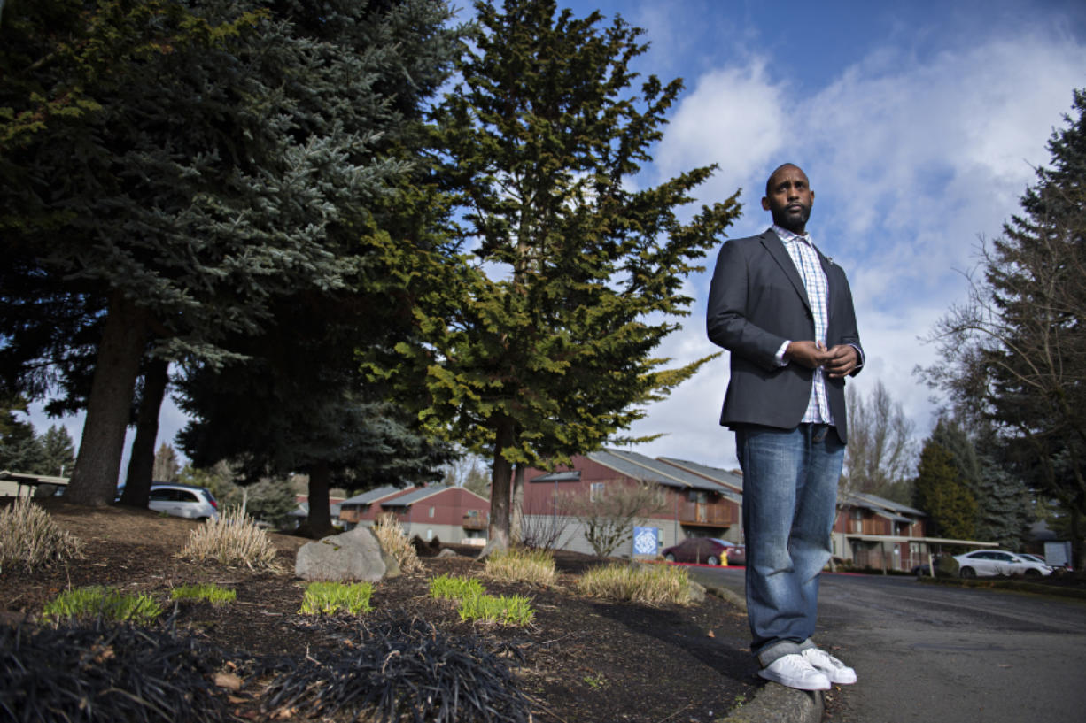 Pastor Damion Young, who contracted COVID-19 and still struggles with symptoms, poses for a portrait at his Vancouver apartment complex. Young worked as an Amazon truck driver, but has struggled to return to work because of long-term symptoms from COVID-19.