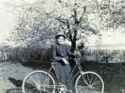 Matilda Stanger Overand shows off her bicycle. While machinists had adapted bicycles for women, clothing designers were farther behind. Although this model has a rear bumper to protect its rider from backsplashes, it lacks a chain guard and is a bit tall for its rider. This helps date the photo to the 1890s. Her father, John Stanger, was a Scotsman who arrived in the area with the Hudson's Bay Company in 1838.