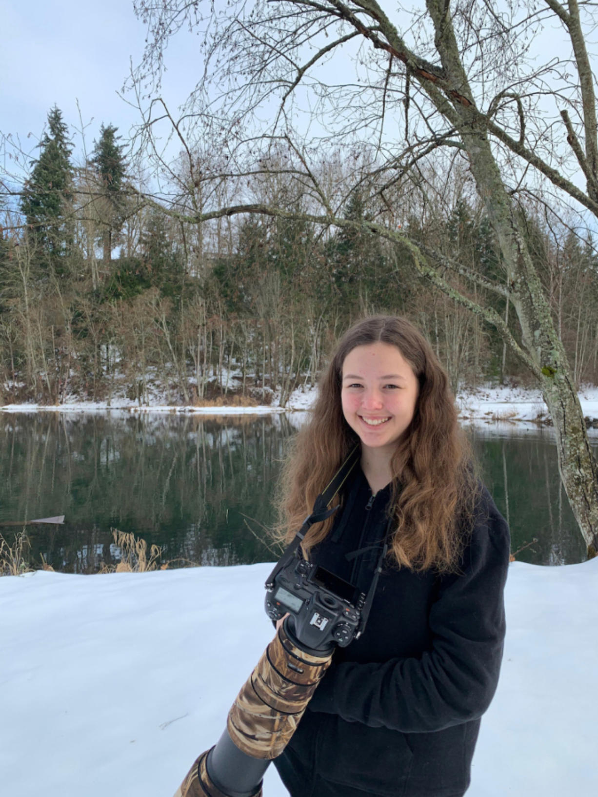 Katie Warner, 13, shown here with her camera near Salmon Creek, was recently named the American Birding Association's 2021 Young Birder of the Year.