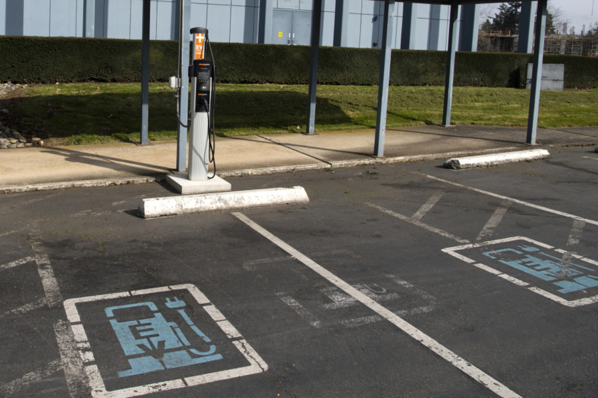An electric vehicle charging station outside the Clark Public Utilities administration building. The utility's commission approved a Transportation Electrification plan Tuesday that will include multiple programs offering rebates for vehicle charging infrastructure.