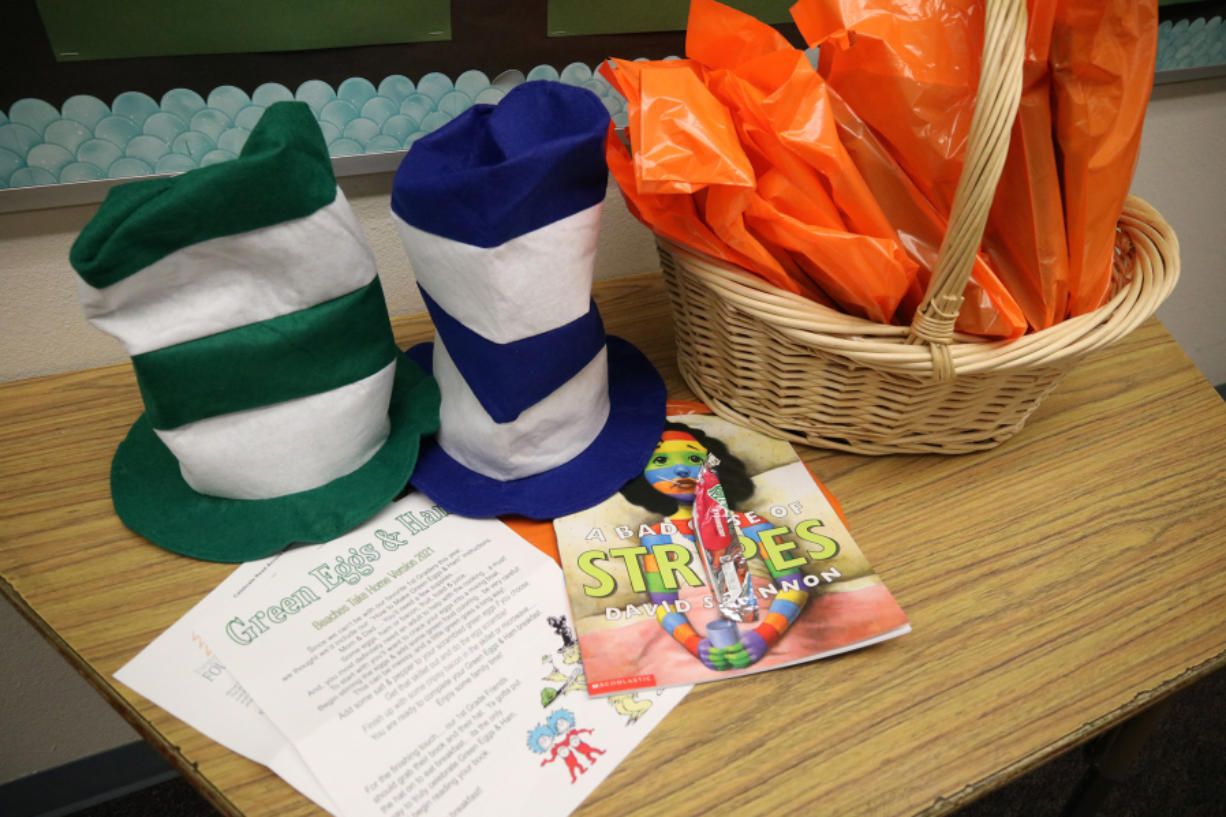 "Local first-graders will get a free ""Green Eggs and Ham"" kit for Read Across America week. The kits, provided by Beaches restaurant and Riverview Community Bank, include green food dye, Dr. Seuss hats, a kids book and instructions on how to make the meal."