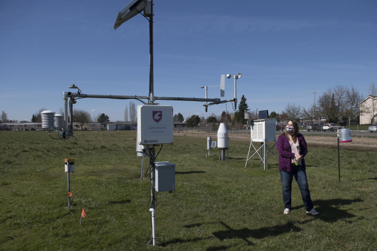 Annette Vary-Getty of Washington State University looks over the current tower of a weather station at the 78th Street Heritage Farm on a recent Friday morning. The tower is set to get a 21st century upgrade.