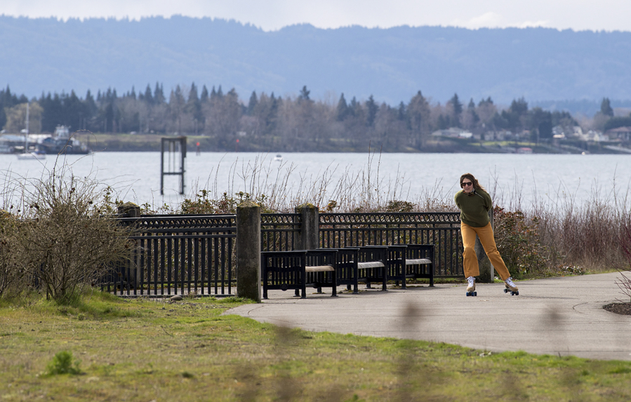 Anna Miller of Vancouver takes in the view during a scenic skate along the Waterfront Renaissance Trail on Monday afternoon. The area is also popular with walkers, runners, boat enthusiasts and cyclists. Forbes named Vancouver the No. 2 place in America to visit during the pandemic.