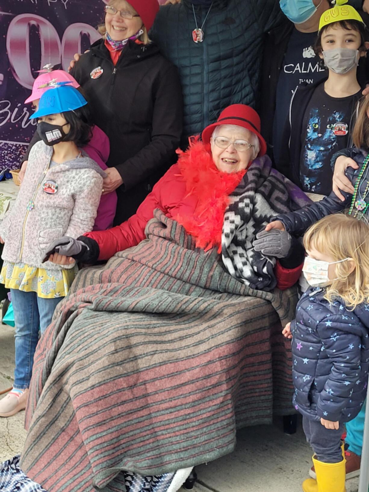 HAZEL DELL: Irma Slocum celebrates with some of her great-grandchildren at her drive-thru 100th birthday.