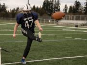 Skyview senior Jordan Mann kicks a field goal during a practice on Tuesday, March 9, 2021, at Skyview High School. Mann joined the football team this year as a kicker.