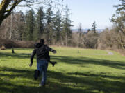 Pete Knight tosses his disc on the 15th hole of the site of the new Hartwood Park disc golf course on Thursday in Washougal.