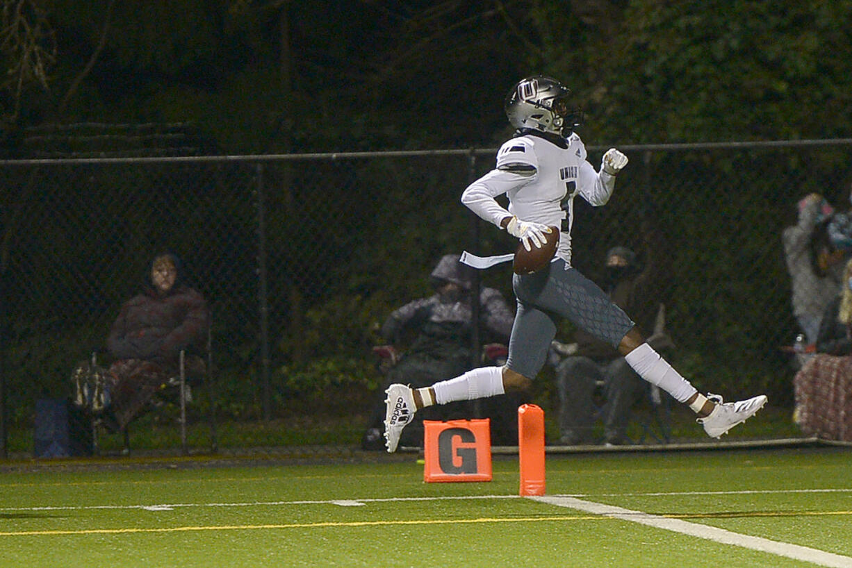 Union's Tobias Merriweather scores a touchdown against Skyview at Kiggins Bowl on Friday night, March 12, 2021.