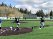 Clark College baseball players, who will compete this spring as the independent club team NW Star, run an infield drill during practice Wednesday at Ridgefield Outdoor Recreation Complex.