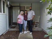 Robin Meyers, Tia Lee, 16, and Mychal Jones stand outside their Vancouver rental home on Saturday. Jones has fallen $14,000 behind on rent since he lost his second job during the pandemic and is hoping to work out a payment plan with the landlord.