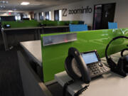 Deserted desks line the main office of ZoomInfo in downtown Vancouver. Many Clark County offices have been empty for more than a year due to the COVID-19 pandemic, although some companies are now eyeing a summer return as vaccination rates pick up.