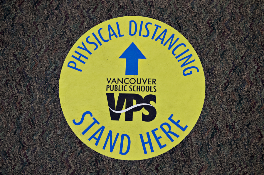 Signs and stickers encourage students and staff to remain social distanced throughout the building at Skyview High School, Vancouver Public Schools' largest high school.