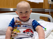 Braxton Manring, 2, smiles while in the hospital for treatment of a blood disorder similar to leukemia.