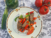 With strips of juicy steak, bell peppers, scallions and tomatoes, this stir-fried meal makes a very colorful plate.