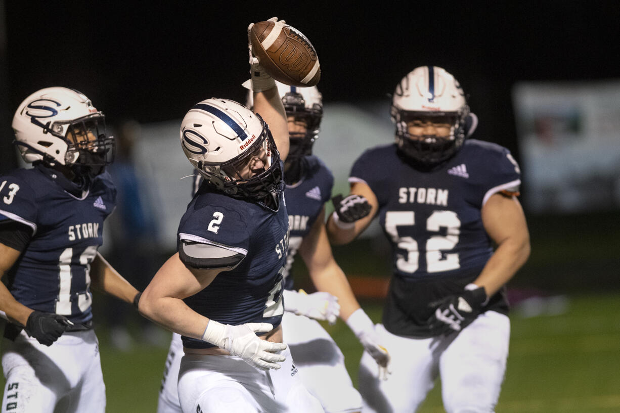 Skyview's Rhett Sarvala spikes the ball after a one-handed 30-yard touchdown catch in a 4A/3A Greater St. Helens League game on Thursday, March 18, 2021, at Kiggins Bowl. Skyview won 49-7.