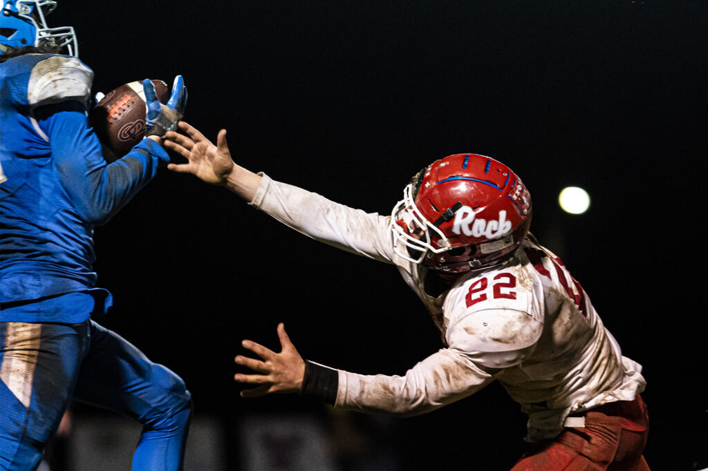 La Center's Jeremy Humphrey intercepts a pass intended for Castle Rock's Landon Gardner during a game at La Center High School on Friday night, March 19, 2021.