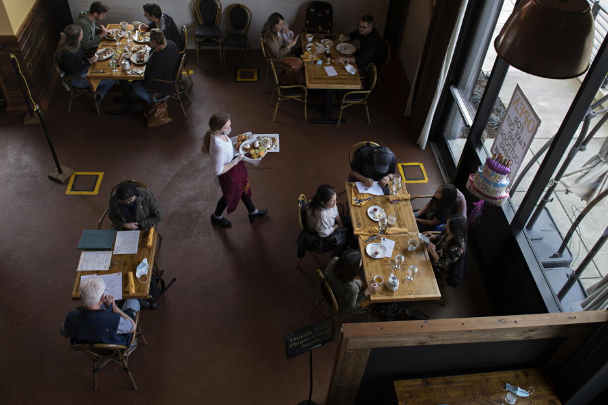 Customers dine at La Provence Vancouver's socially distanced dining area as lunch is served Thursday afternoon.