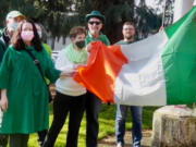 ESTHER SHORT: Family and friends of Denny Lane, the city's first constable, raised an Irish flag in front of the Clark County courthouse on St.