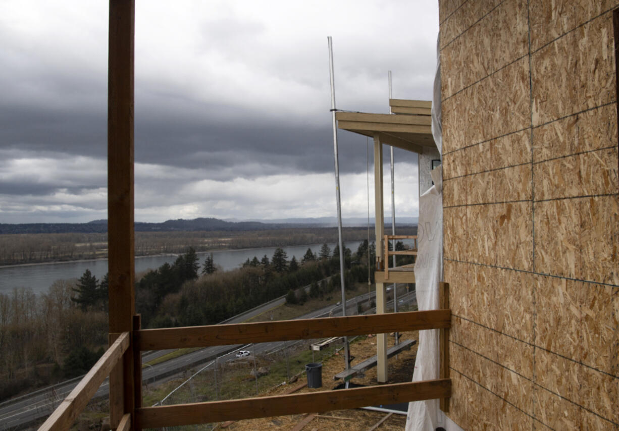 Cars bustle down Highway 14, hundreds of feet below the deck of a town home at the Boulder Ridge development in the Columbia Palisades neighborhood on the border of Vancouver and Camas. The Boulder Ridge development is expected to be complete within a year.