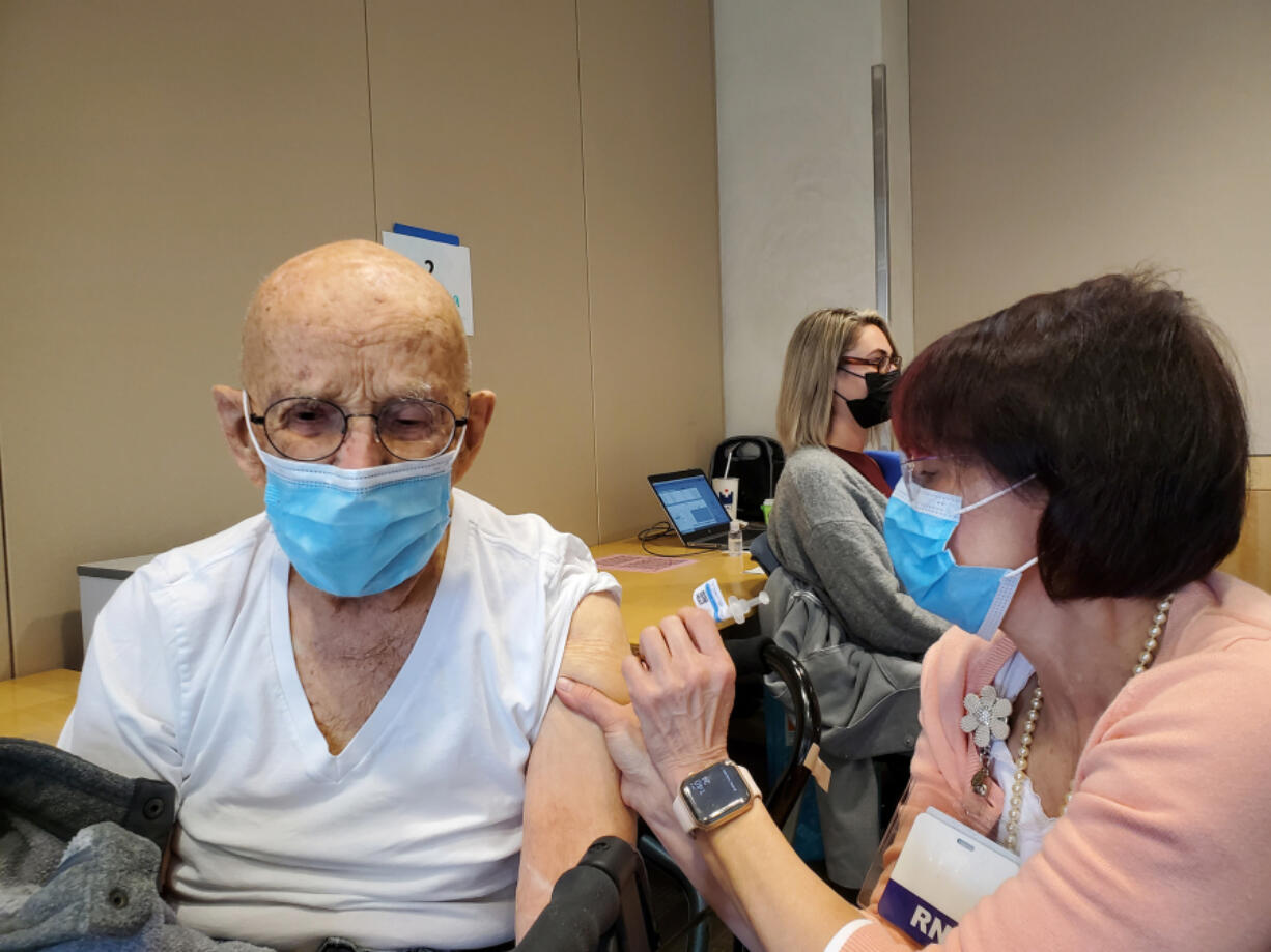 Earl Bolton receives his second dose of the COVID-19 vaccine in late March at Legacy Salmon Creek Medical Center in Salmon Creek.
