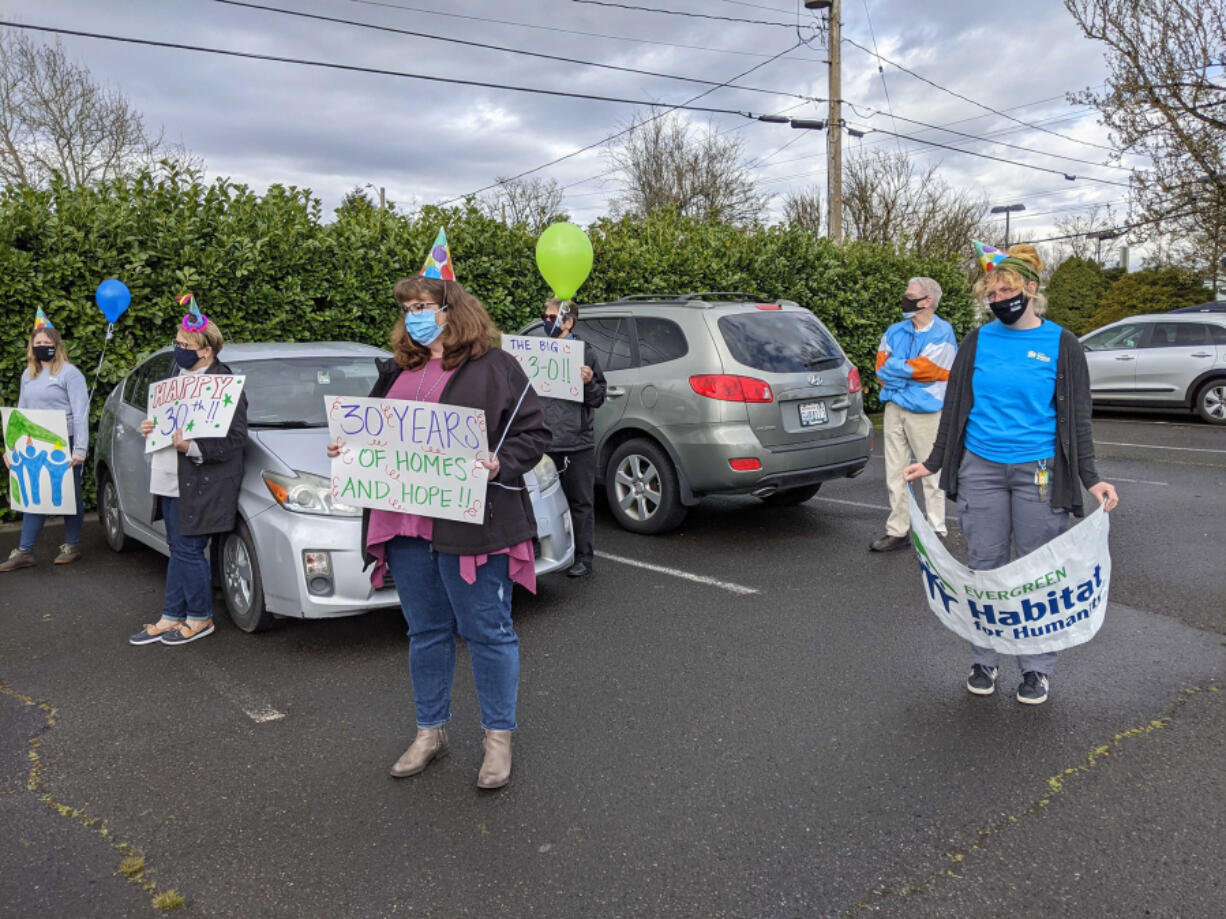 ELLSWORTH SPRINGS: Volunteers, staff and board members held a socially-distant event outside the Clark County Habitat for Humanity Store on March 18 to celebrate its 30th birthday.