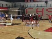 Members of the Camas volleyball team waves to Kelso players after Camas beat Kelso 3-1 on Thursday.