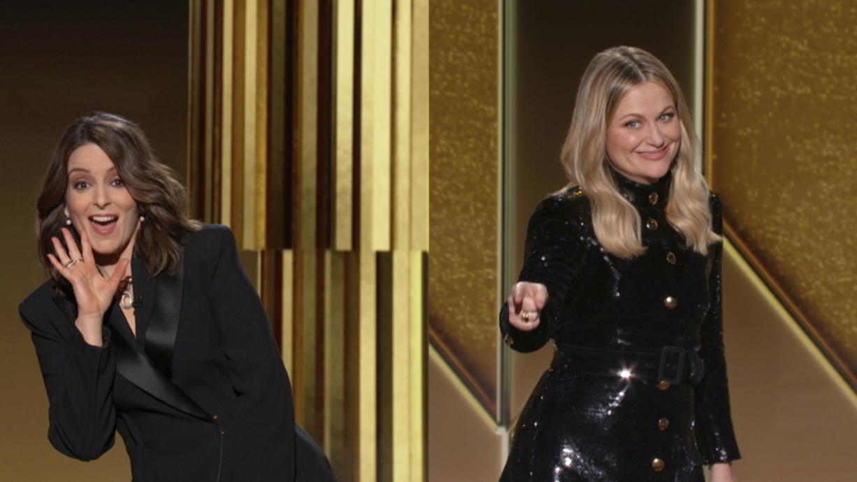 In this video grab issued Sunday, Feb. 28, 2021, by NBC, hosts Tina Fey, left, from New York, and Amy Poehler, from Beverly Hills, Calif., speak at the Golden Globe Awards.