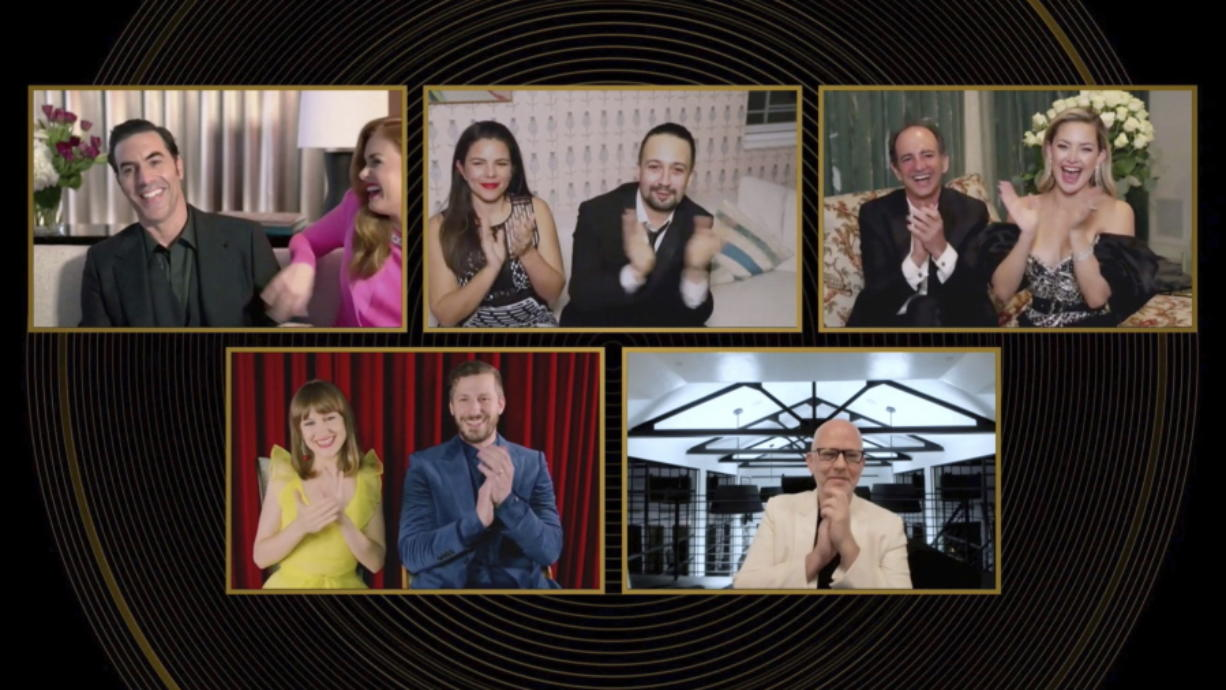 In this image from video, nominees in the category best actor in a motion picture, musical or comedy, react as Sacha Baron Cohen, top left, is announced as the winner Sunday at the Golden Globe Awards.