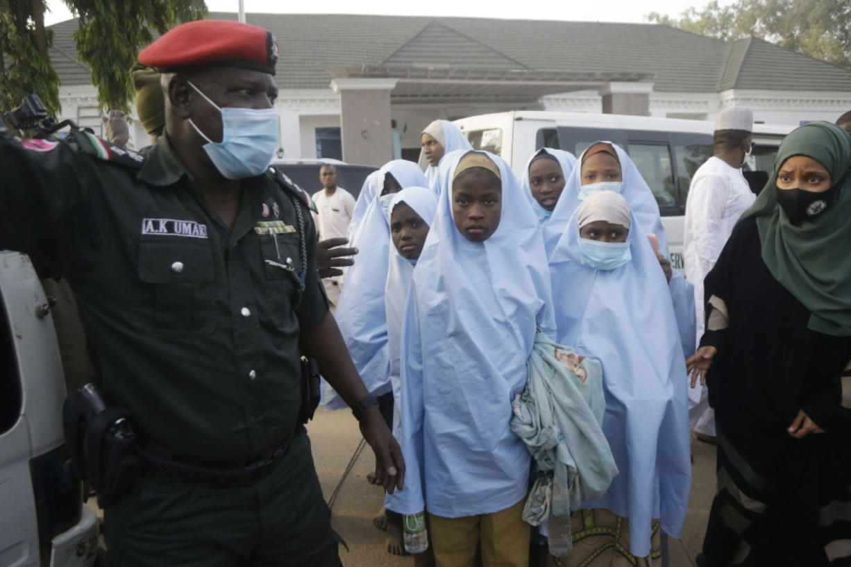 Some of the students who were abducted by gunmen from the Government Girls Secondary School, in Jangebe, last week wait for a medical checkup after their release meeting with the state Governor Bello Matawalle, in Gusau, northern Nigeria, Tuesday, March 2, 2021.