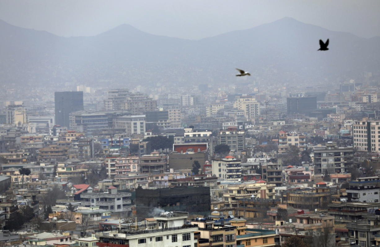FILE - In this Feb. 1, 2021 file photo, birds flyover the city of Kabul, Afghanistan. The United States wasted billions of dollars in war-torn Afghanistan on buildings and vehicles that were either abandoned or destroyed, according to a report released Monday, March 1, 2021, by the Special Inspector General for Afghanistan Reconstruction, a U.S. government watchdog.