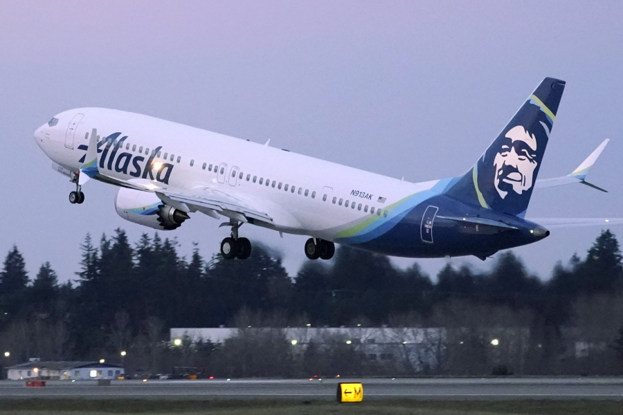 FILE - The first Alaska Airlines passenger flight on a Boeing 737-9 Max airplane takes off, Monday, March 1, 2021, on a flight to San Diego from Seattle-Tacoma International Airport in Seattle.   Boeing says it got more new orders than cancellations for planes in February.  Boeing said Tuesday, March 9, that it received 82 new orders and 51 cancellations last month, for a net gain of 31.    (AP Photo/Ted S.
