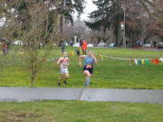 Hockinson's Allyson Peterson (front) leads Washougal's Elle Thomas in the girls races at the 2A district cross country meet at Hudson's Bay High School on Thursday, March 18, 2021 (Tim Martinez/The Columbian)