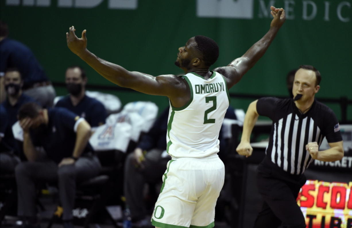 Oregon forward Eugene Omoruyi (2) celebrates after making a three-point basket against Arizona during the first half of an NCAA college basketball game Monday, March 1, 2021, in Eugene, Ore.