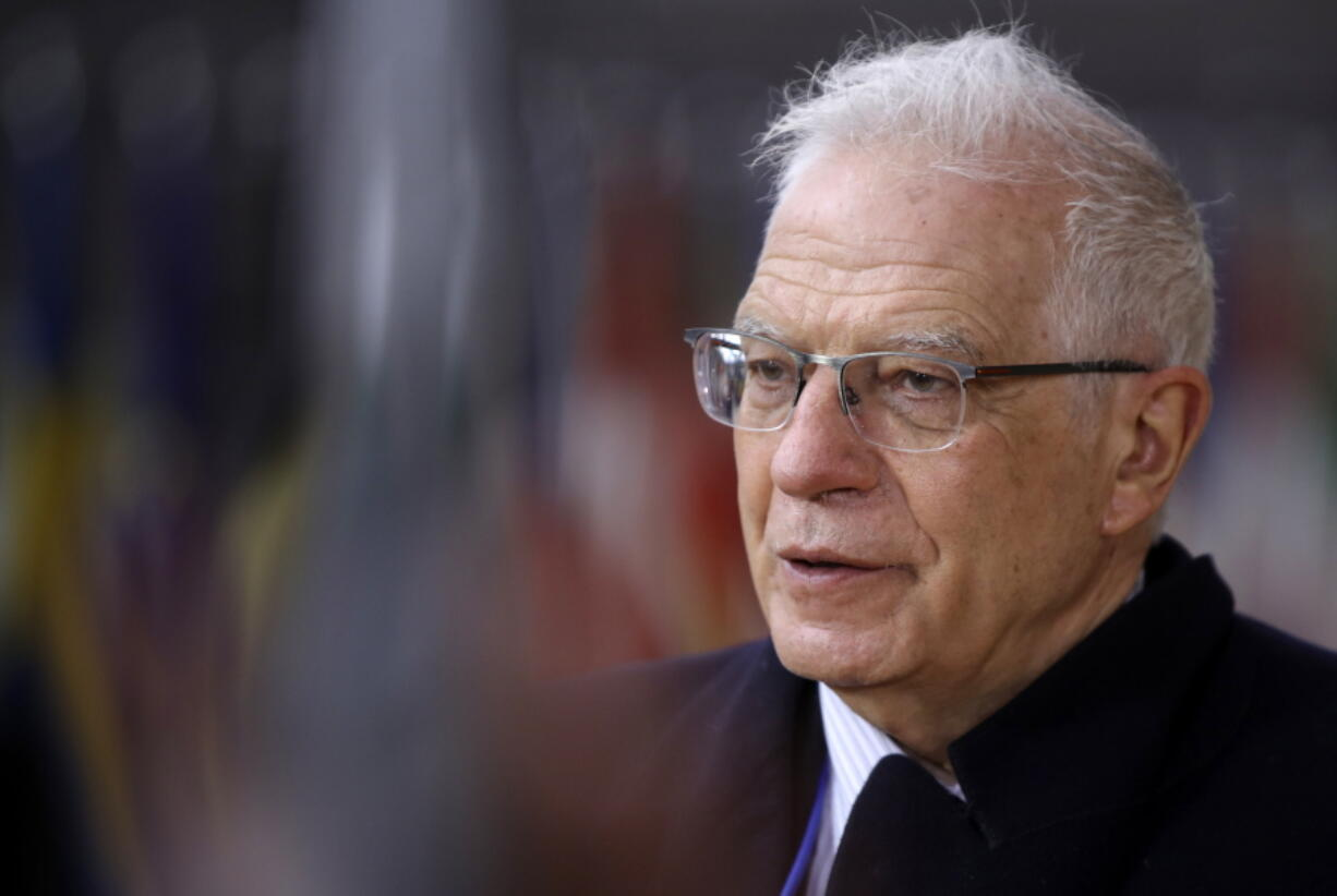 European Union foreign policy chief Josep Borrell speaks with the media as he arrives for a meeting of EU Foreign and Interior ministers at the European Council building in Brussels, Monday, March 15, 2021.