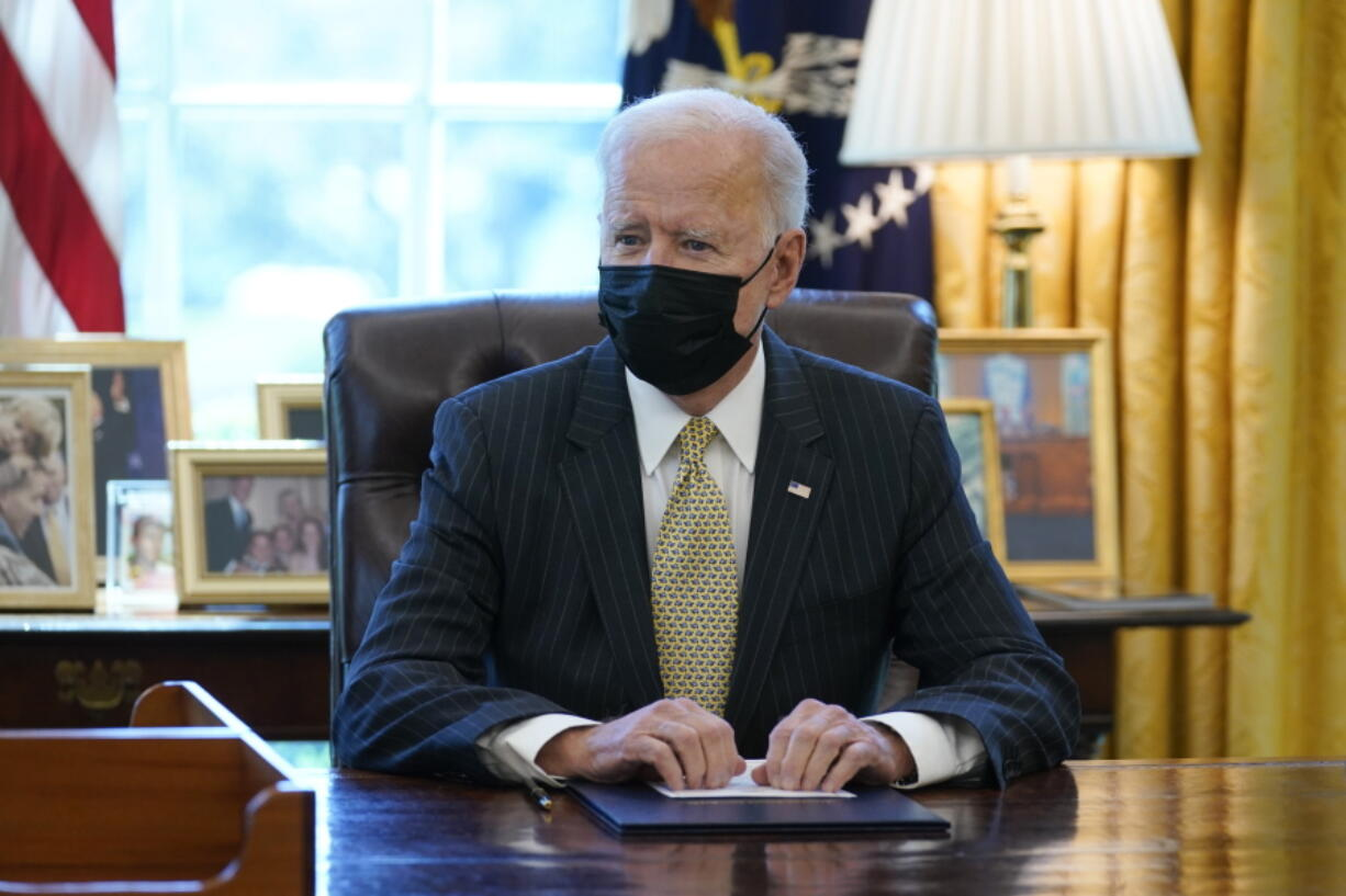 President Joe Biden speaks after signing the PPP Extension Act of 2021, in the Oval Office of the White House, Tuesday, March 30, 2021, in Washington.