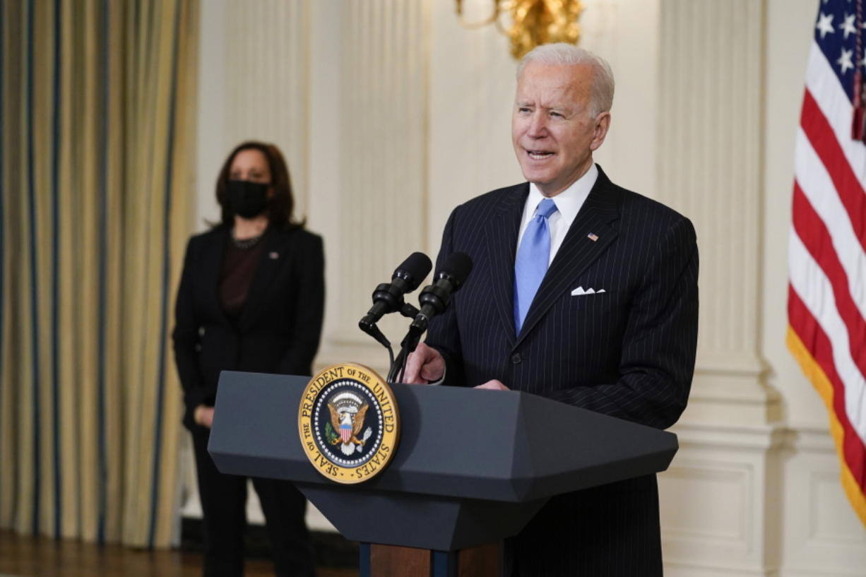 President Joe Biden, accompanied by Vice President Kamala Harris, speaks about efforts to combat COVID-19, in the State Dining Room of the White House, Tuesday, March 2, 2021, in Washington.