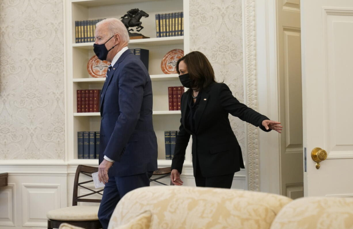 President Joe Biden and Vice President Kamala Harris, arrive at the Oval Office of the White House, Thursday, March 11, 2021, in Washington.