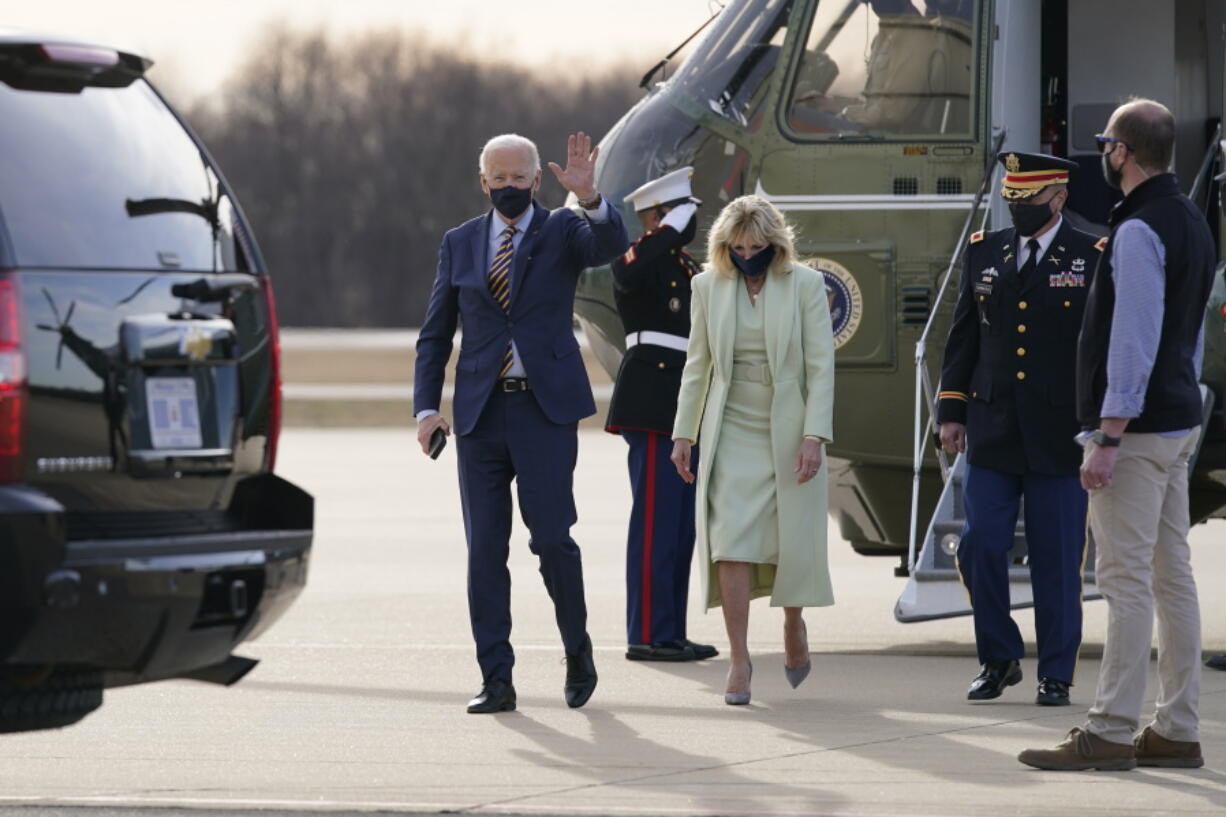 FILE - In this March 12, 2021, file photo President Joe Biden and first lady Jill Biden walk to a motorcade vehicle after stepping off Marine One at Delaware Air National Guard Base in New Castle, Del. The Bidens are spending the weekend at their home in Delaware.