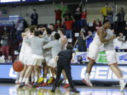 Eastern Washington players celebrate a 65-55 win over Montana State during an NCAA college basketball game for the championship of the Big Sky men's tournament in Boise, Idaho, Saturday, March 13, 2021.