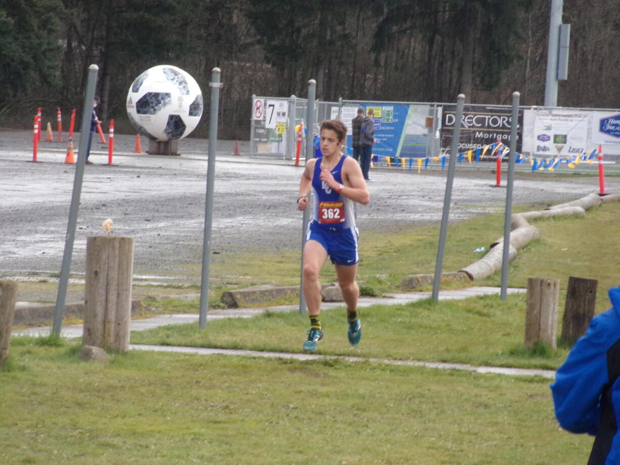La Center's Joseph Blanshan runs in the 1A district cross country meet at Harmony Sports Complex on March 19, 2021 (Tim Martinez/The Columbian)