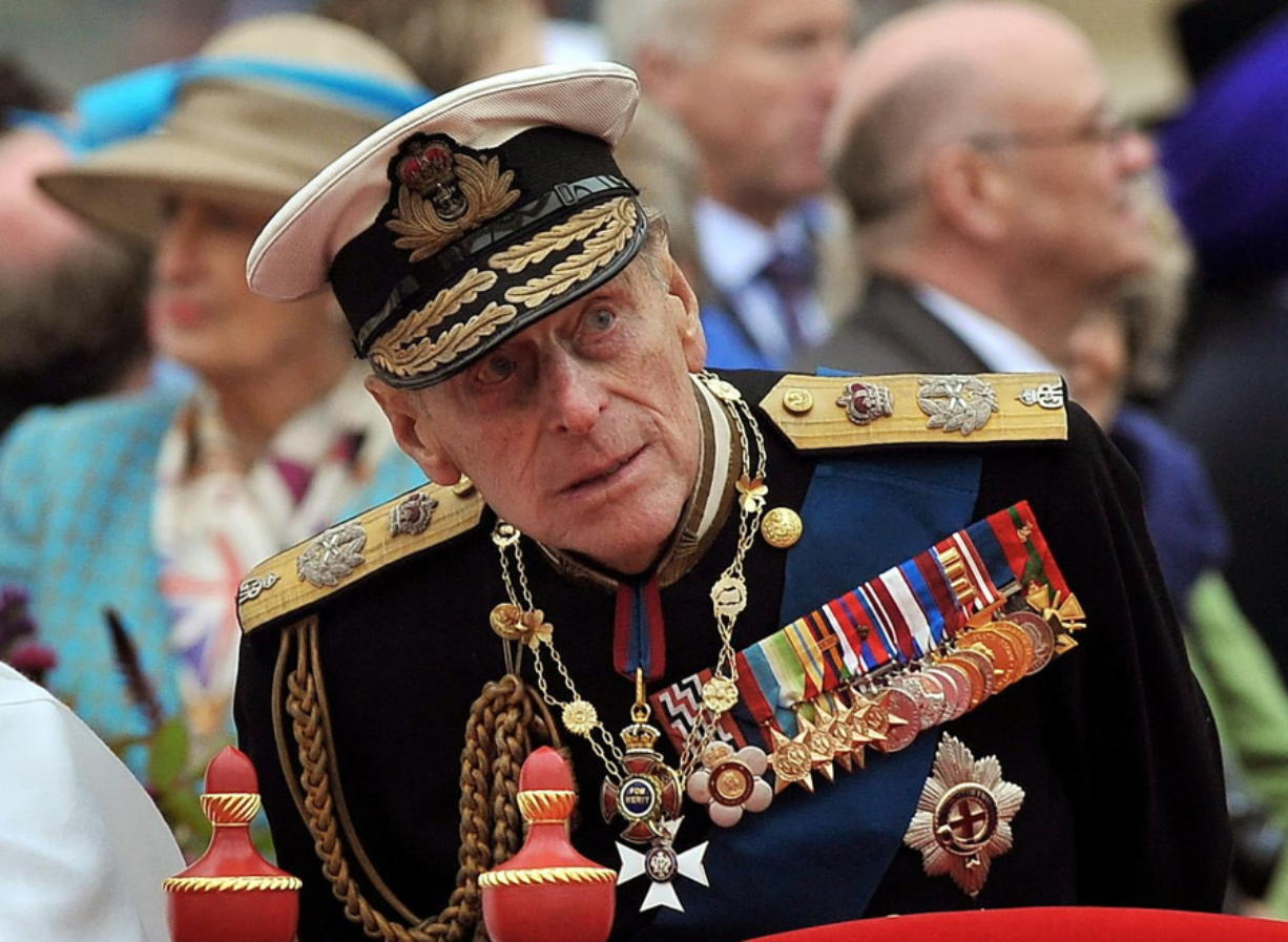 FILE - A Sunday June 3, 2012 photo from files showing Prince Philip watching the proceedings from the royal barge during the Diamond Jubilee Pageant on the River Thames in London.