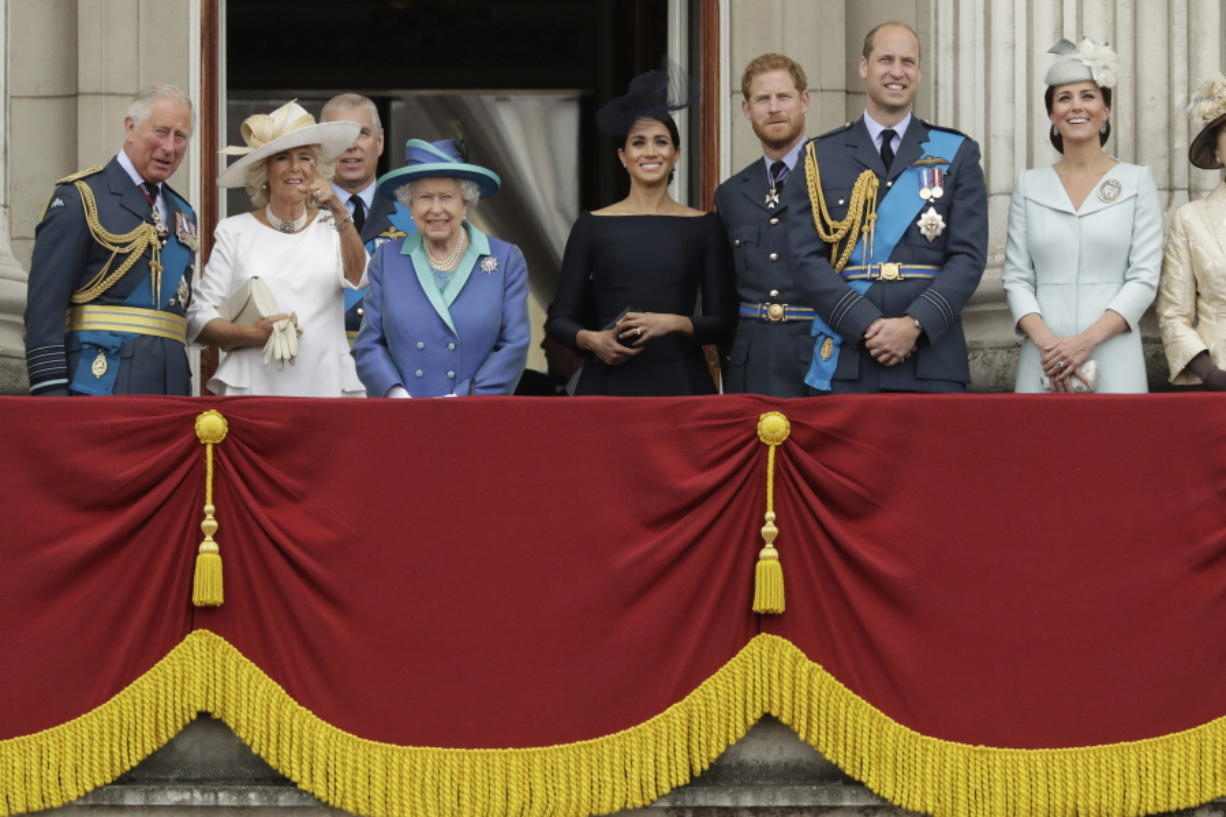 FILE - In this Tuesday, July 10, 2018 file photo, members of THE royal family gather on the balcony of Buckingham Palace, with from left, Britain's Prince Charles, Camilla the Duchess of Cornwall, Prince Andrew, Queen Elizabeth II, Meghan the Duchess of Sussex, Prince Harry, Prince William and Kate the Duchess of Cambridge, as they watch a flypast of Royal Air Force aircraft pass over Buckingham Palace in London. The timing couldn't be worse for Harry and Meghan. The Duke and Duchess of Sussex will finally get the chance to tell the story behind their departure from royal duties directly to the public on Sunday, March 7, 2021 when their two-hour interview with Oprah Winfrey is broadcast.