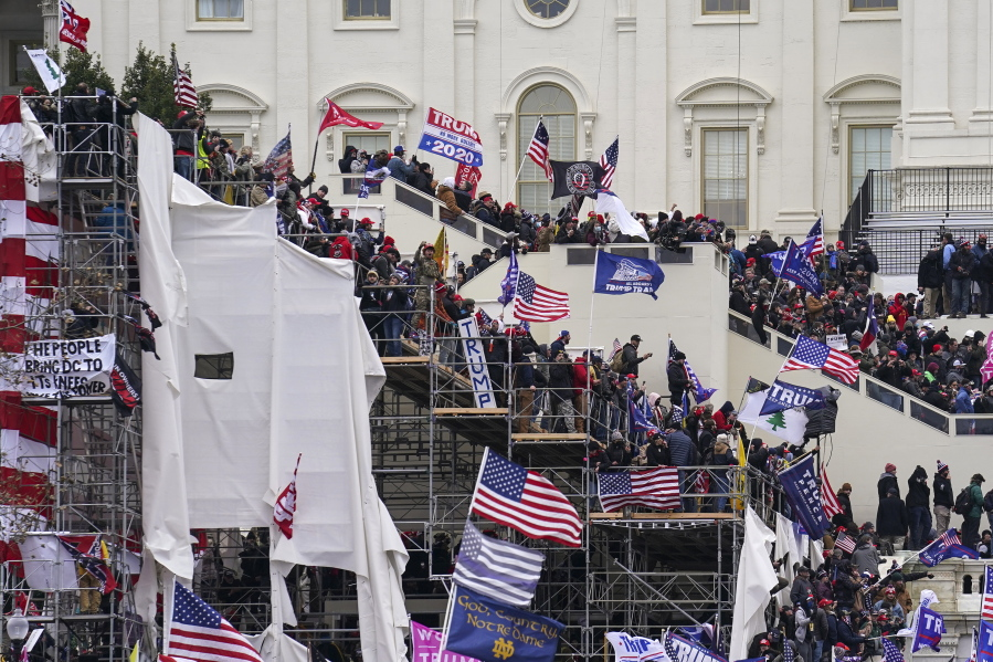 FILE - In this Jan. 6, 2021 file photo insurrectionists loyal to President Donald Trump riot outside the Capitol in Washington.