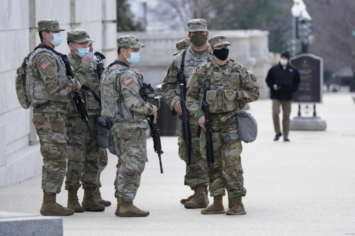 """National Guard keep watch on the Capitol, Thursday, March 4, 2021, on Capitol Hill in Washington. Capitol Police say they have uncovered intelligence of a """"possible plot"""" by a militia group to breach the U.S. Capitol on Thursday, nearly two months after a mob of supporters of then-President Donald Trump stormed the iconic building to try to stop Congress from certifying now-President Joe Biden's victory."""