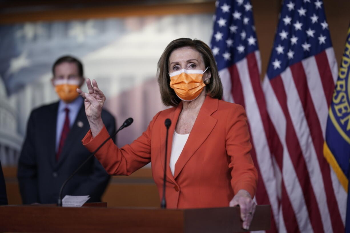 Speaker of the House Nancy Pelosi, D-Calif., holds a news conference on passage of gun violence prevention legislation, at the Capitol in Washington, Thursday, March 11, 2021, as Sen. Richard Blumenthal, D-Conn., looks on. (AP Photo/J.
