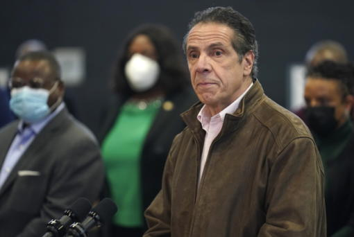FILE - In this Feb. 22, 2021 photo, New York Gov. Andrew Cuomo, right, pauses to listen to a reporter's question during a news conference at a COVID-19 vaccination site in the Brooklyn borough of New York. New York's attorney general said she's moving forward with an investigation into sexual harassment allegations against the governor after receiving a letter from his office Monday authorizing her to take charge of the probe.